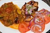 charcoal - grilled chicken breast with aji sauce, eggplant chorizo relish, tomato salad