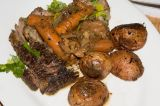 braised beef served with pan roasted red potatoes