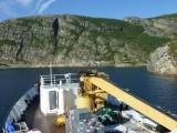 Navigating a narrow passage between some islands