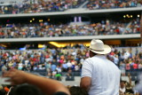 A lone cowboy watching the fans find their seats