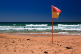 Surf life saving flag at Warriewood Beach