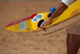 Surfer carrying surf kayak at Palm Beach surf carnival
