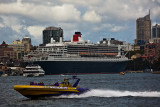 Queen Mary 2 in Sydney Harbour with jetboat foreground
