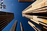 Aboriginal sound poles amongst city buildings