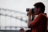 Tourist on Manly  ferry with Sydney Harbour Bridge backdrop