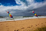 Two Bali flags during Collaroy storm
