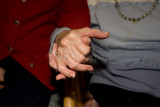 Aged couple holding hands