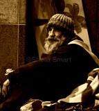 Homeless man at Quay in sepia
