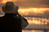 Man on ferry with Sydney Harbour Bridge backdrop