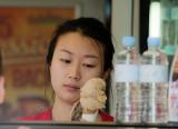 Pretty Asian girl selling ice cream