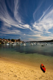 Manly Cove with single kayak and cirrus clouds
