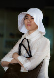 Asian lady holding handbag