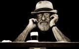 Bearded man on phone in monochrome