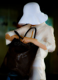 Lady with hat and bag