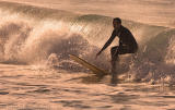 Surfer in late afternoon  winter sun
