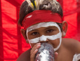 Aboriginal child with didgeridoo