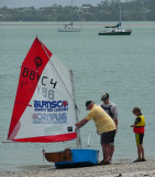 Teaching little Johnnie to sail.