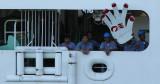 Engine room workers waving a BIG hand.. LOL...