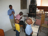 after church in Petionville, this small boy was playing the drums