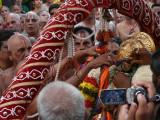 Peyazhwar getting parivattam from Parthasarathi.jpg