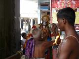 Peyazhwar receiving srisatakopa mariyadai from kesavan after purappadu.jpg