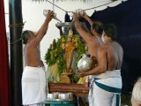 Azhagiya singar undergoing thirumanjanam.jpg