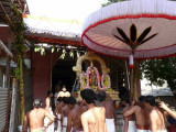 Parthasarathi going into davanOtsava bangalow.jpg