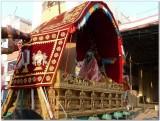TheerthavAri day - Parthasarathy in Alum pallakku engulfed in pallakku.jpg