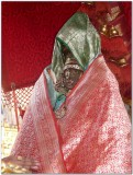 TheerthavAri day -Parthasarathi engulfed in 9 pOrvais (blankets) - closeup.jpg