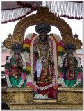Thiruvadipooram utsavam -Parthasarathi with ubaya nacchiayars -closeup shot.jpg