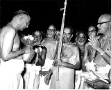 Sri TSRajam (TVSChairman) receiving Tirukudanthai Andavan with poornakumbam -Sri ASR swamy looks on.JPG