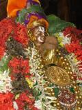 sri_pillai_lokacharya_adorned_with_peria_perumal_prasadam_at_peria_koil.jpg