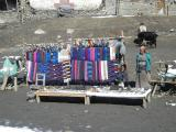 Tibetan's platform-shop near temple - see the locally found salagrama mUrthis on the left side baskets