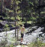 Brian dips in Owen Creek