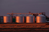 Sunset Reflection on Grain Bins