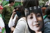 A protester at the UN carrying a poster of Neda Agha-Soltan