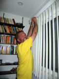 Adjusting the blinds in the study