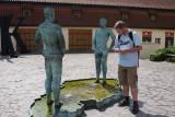 Inspecting One of David Cerny's Irreverent Sculptures