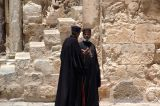 Priests in the courtyard of the Church of the Holy Sepulchre