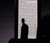 The guy behind, or in front of, the basic e-Ink Kindle