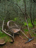 Forgotten rake and rickety woven chair