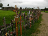 Rows of crosses leading up to the hill