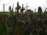 Crosses wooden and metal atop the hill