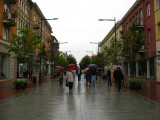 Umbrella-wielding locals on Vilniaus gatvė