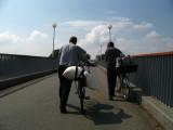 Wheeling bikes across the footbridge