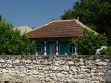House and stone wall in Butuceni