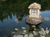 Stone lantern at the pond's edge
