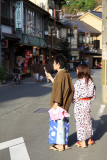 Young couple in yukata on the main street