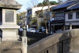 Bridge lantern and storefronts beyond