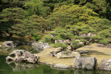 Sculpted trees upon an islet in Kansui-chi